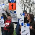 Health care reform supporters protest outside Tea Party gathering