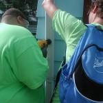 Agape installs rain barrels, builds community