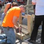 Volunteers build playground designed by neighborhood kids