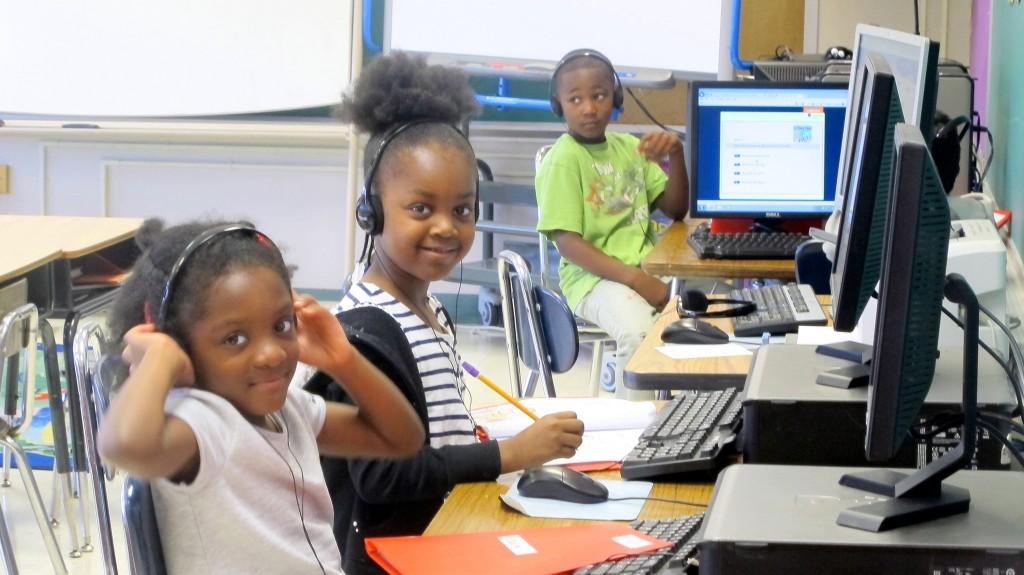 Students at Thurston Woods, which is one of 14 underperforming MPS schools participating in the Commitment Schools program, work on assignments. (Photo by Molly Rippinger)
