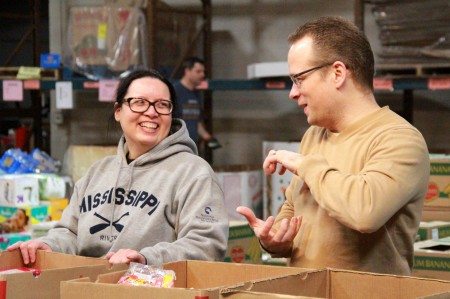 Leanne Drives and Kevin Buss, employees of Northwestern Mutual, volunteer at Feeding America Eastern Wisconsin. (Photo by Molly Rippinger)