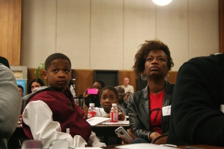 Sharlen Moore, director of Urban Underground, and her 11-year-old son, Malachi. (Photo by Jabril Faraj)