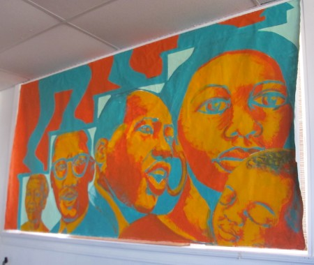 Staff visual artist Ammar Nsoroma worked with teens in the Milwaukee County Accountability Program to produce this mural. (Photo by Teran Powell)