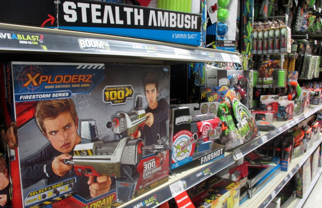 An aisle at a local toy store is devoted to guns and other weapons for young boys. (Photo by Teran Powell)