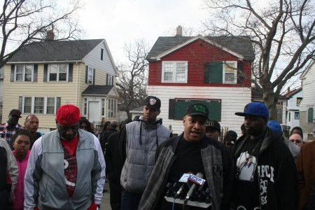 William Harris Jr., Vice Lords (left); Torre Johnson, X-men (at microphone); and Terry O'Kelly Jr., Growth & Development (right) speak at a March 20 press conference in Garden Homes. (Photo by Jabril Faraj)