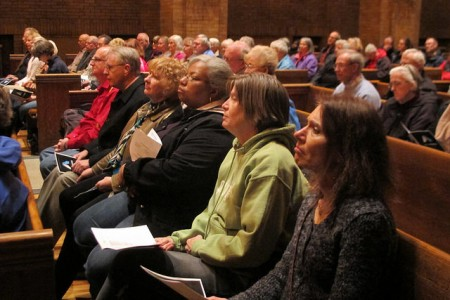 Participants at the service hear prayers written by audience members. (Photo by Wyatt Massey)
