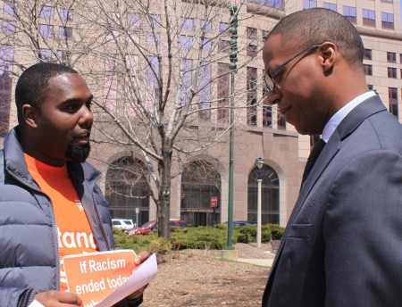 Barney Moore (right) shares his thoughts on racism with YWCA volunteer Donte Moore (no relation). (Photo by Matthew Wisla)