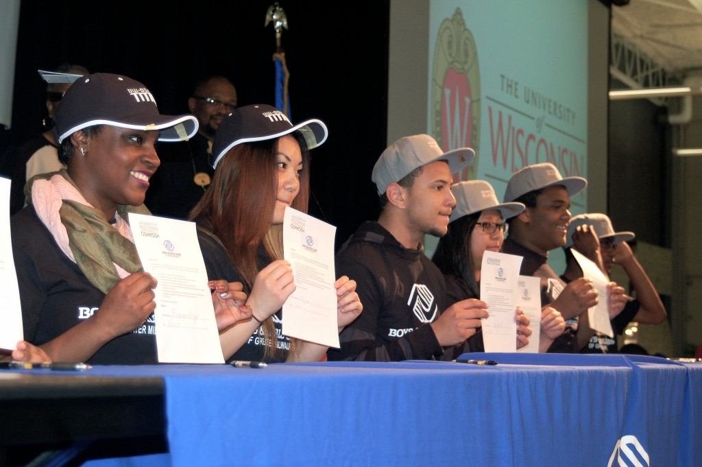 Students hold up their college letters of intent at the second annual college signing day. (Photo by Molly Rippinger)