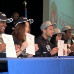 High school seniors commit to higher education at college signing day