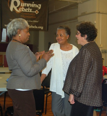 Walnut Way co-founder Sharon Adams mingles with community members prior to the event. (Photo by Devi Shastri)