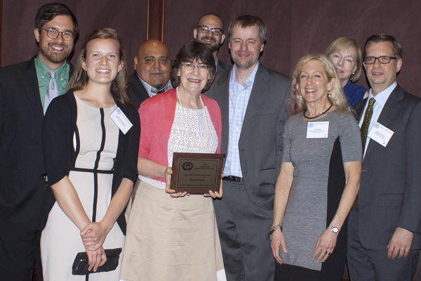 Milwaukee Neighborhood News Service staff members celebrate at the Gridiron dinner. From left: Adam Carr, Molly Rippinger, Edgar Mendez, Sharon McGowan (holding plaque), Jabril Faraj, Brendan O'Brien, Sue Vliet, Andrea Waxman and Matthew Wisla. (Photo by Jim McGowan)