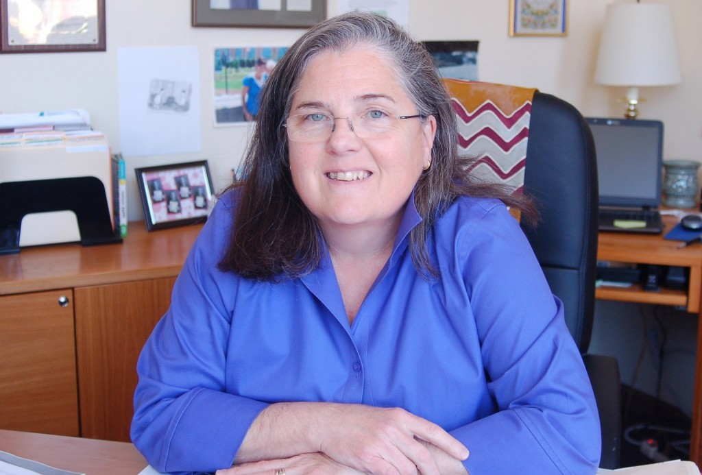 Executive Director Carmen Pitre will continue working in her office at the Germania Building until the new Sojourner Family Peace Center opens in late 2015. (Photo by Andrea Waxman)