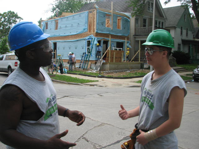 YouthBuild participants Deshawn Washington (left) and Michael Merkel discuss the house they helped build with Milwaukee Habitat for Humanity. (Photo by Brendan O'Brien)