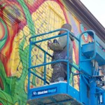 A mural is born: Watch artist create new public artwork
