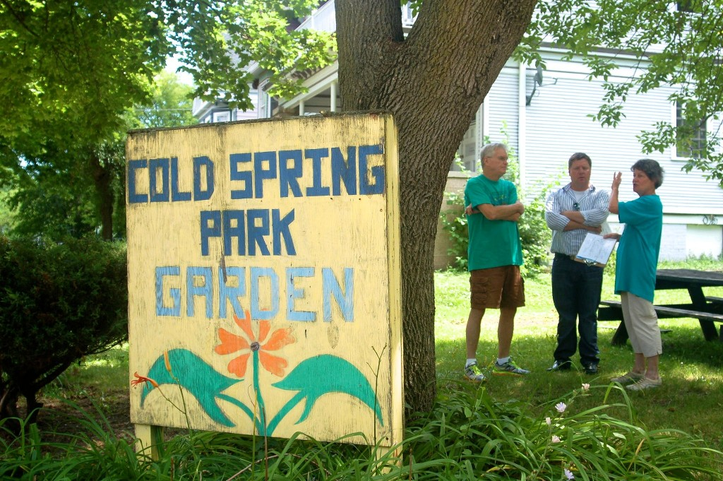 Joyce Seiser, her husband Charlie Seiser, and Scott Baran from the city Department of Public Works discuss plans and infrastructure for the new Cold Spring Park Garden. (Photo by Allison Dikanovic)