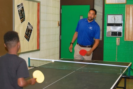 Sprewell plays a few rounds of ping-pong with middle school boys at the North Division Boys & Girls Club. (Photo by Andrea Waxman)