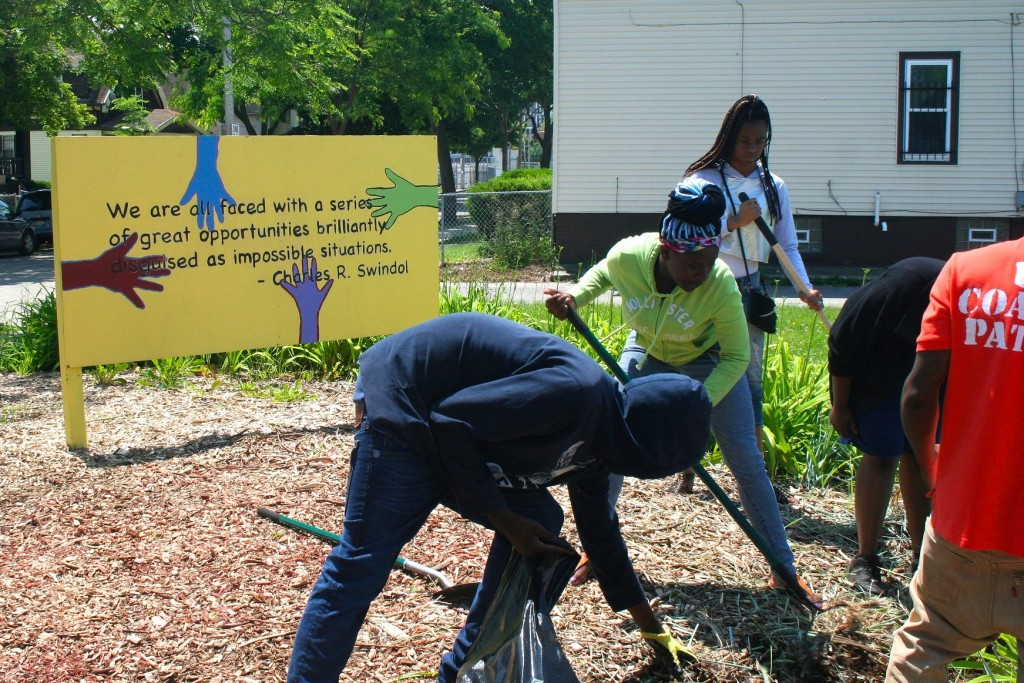 Cleveland Easley and other students work at a pocket park on 19th Street and Meinecke Avenue. (Photo by Jabril Faraj)