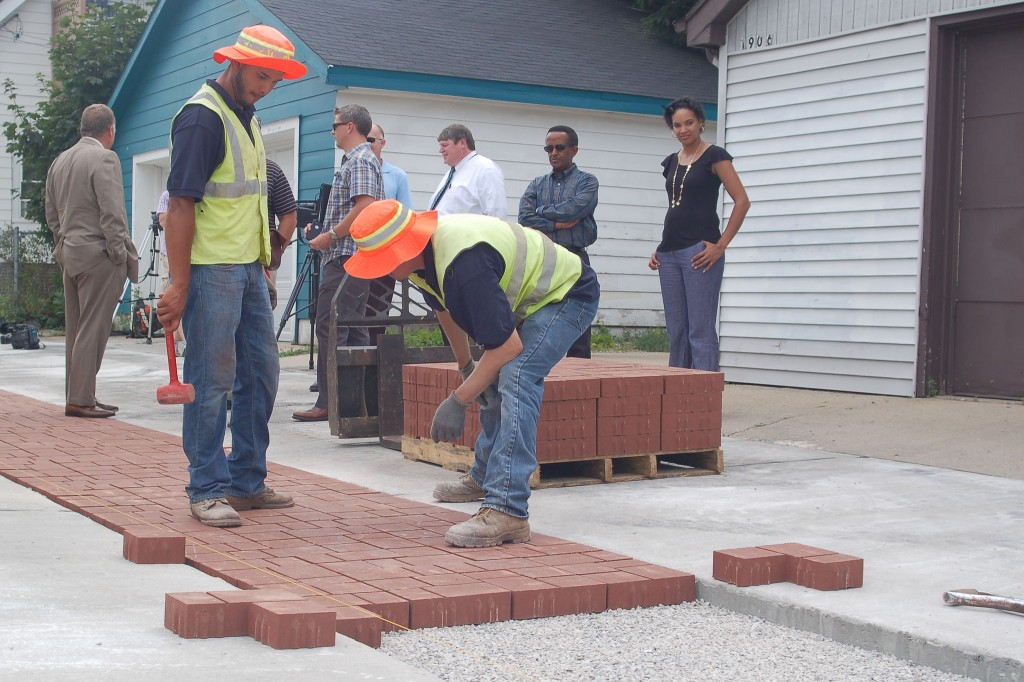 Landscapers strategize how to best place the permeable pavement in the Windlake alley. (Photo by Devi Shastri)