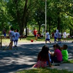 Children gather to watch the soccer game at 10th Street and Lincoln Avenue. (Photo by Sue Vliet)