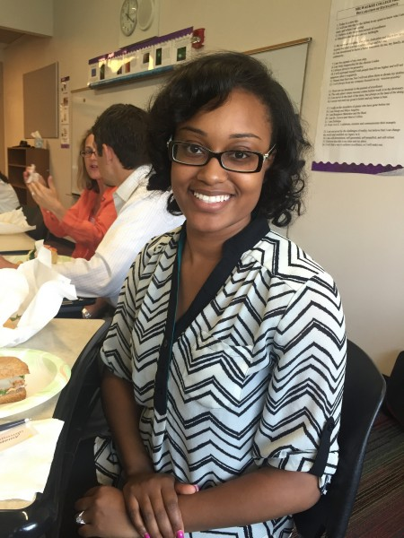 Tianna McCullough, instructional coach for culture at Carver Academy, takes a lunch break after the morning session on adult learning principles. (Photo by Andrea Waxman)