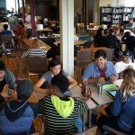 Students work on independent group projects in the school's second floor open-concept space. (Photo by Adam Carr)