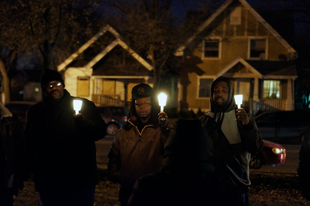 Last winter, community members prayed for peace at a candlelight vigil organized by Amani United and the Dominican Center for Women. (Photo by Adam Carr)