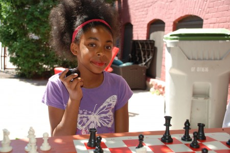 "Quan Caston named fifth-grader Elana Sinclair ""Chess Student of the Summer"" for being a self-starter with an excellent attitude. (Photo by Andrea Waxman)"