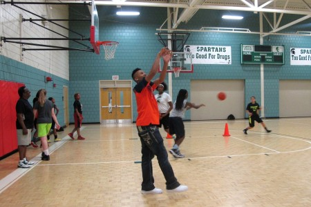Te'Jon Lucas shoots hoops at the Silver Spring Neighborhood Center. (Photo by Stephanie Harte)