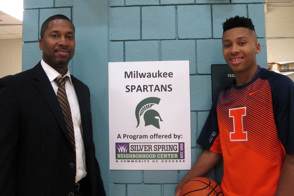 Anthony McHenry coaches Te'Jon Lucas on the Milwaukee Spartans basketball team. (Photo by Stephanie Harte)