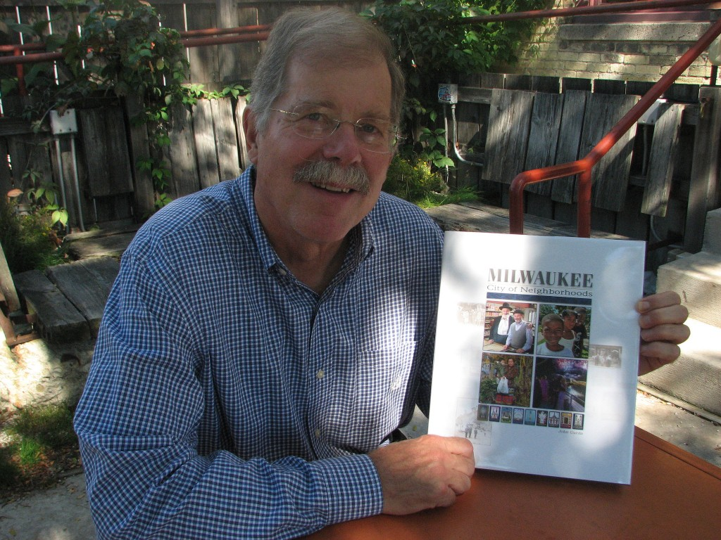 "John Gurda with his new book ""Milwaukee: City of Neighborhoods."" (Photo by Brendan O'Brien)"