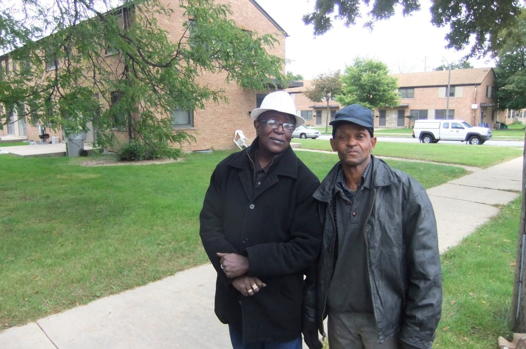 Lynell Quin (right) and Clarence Lee said the Westlawn neighborhood needs better parks and a pharmacy. (Photo by Wyatt Massey)