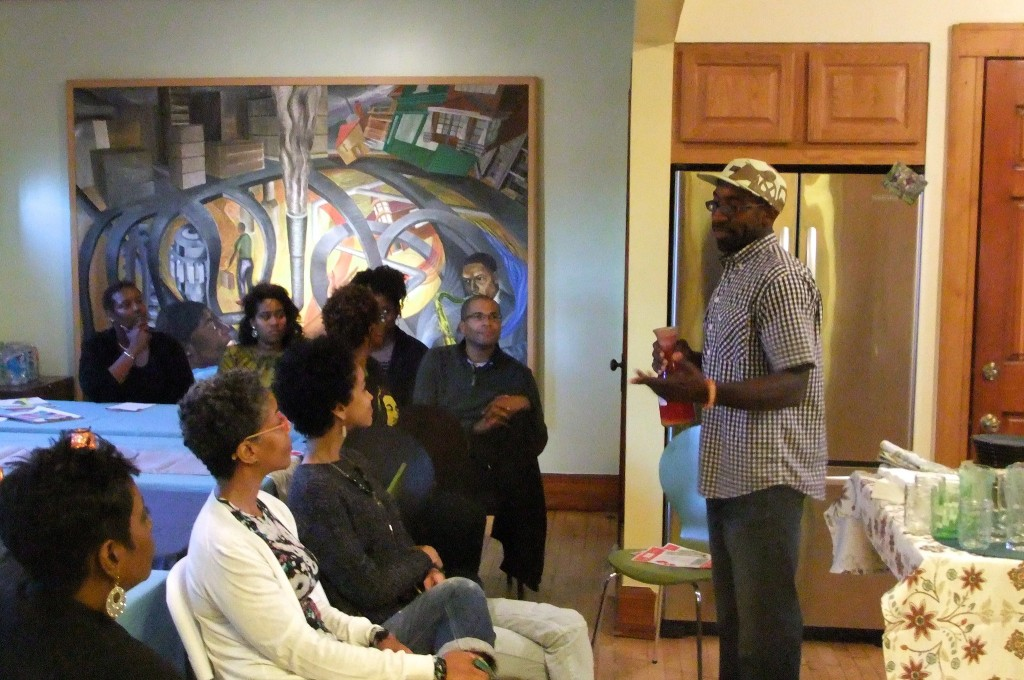 Maanaan Sabir talks about his new business, The Juice Kitchen, at Walnut Way Conservation Corp. (Photo by Wyatt Massey).