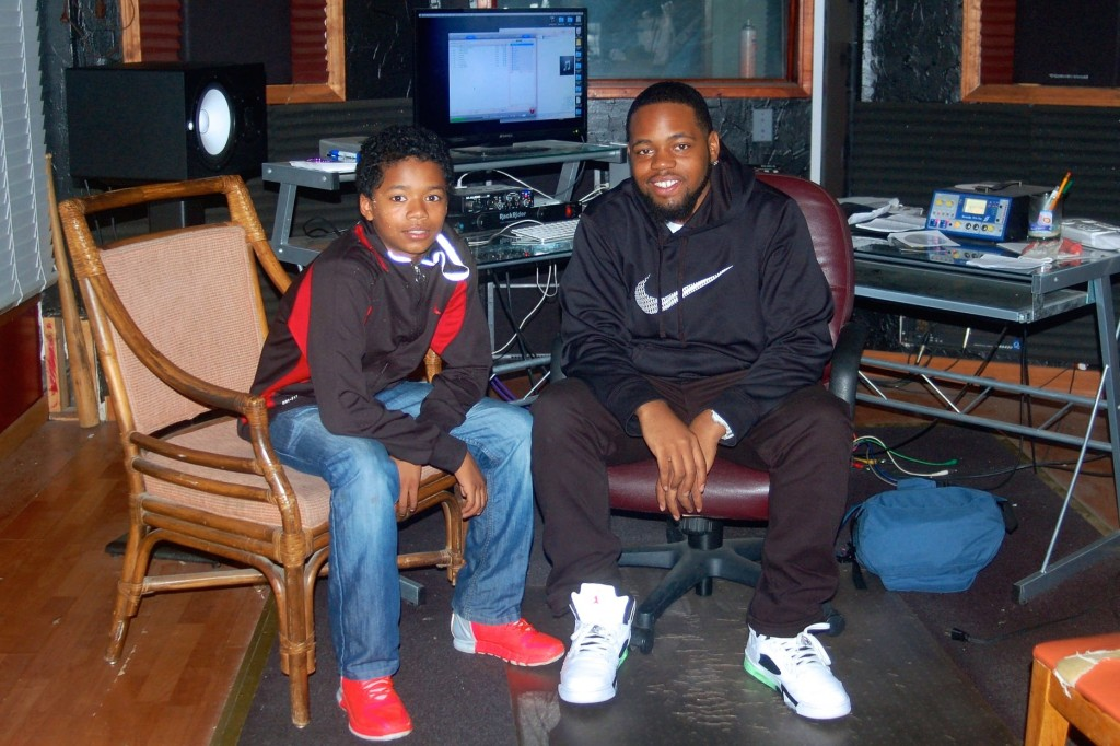 Victor Barnett Jr. and his mentor Dae Hill produce their rap music in the studio at Running Rebels. (Photo by Allison Dikanovic)