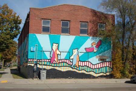 The mural wraps around the vacant building on the northeast corner of Lisbon Avenue and 31st Street. Here it is viewed from Lisbon Avenue. (Photo by Andrea Waxman)