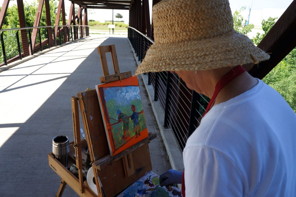 A plein air paints in the Menomonee Valley. (Photo by Adam Carr)