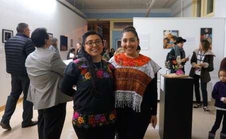 Marcela and Dina Garcia (left to right) welcome guests to the grand opening of their gallery. (Photo by Adam Carr)