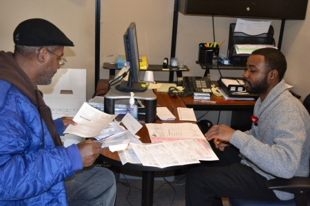 A volunteer tax preparer works with a client at SDC's Teutonia site. (Photo courtesy of SDC)