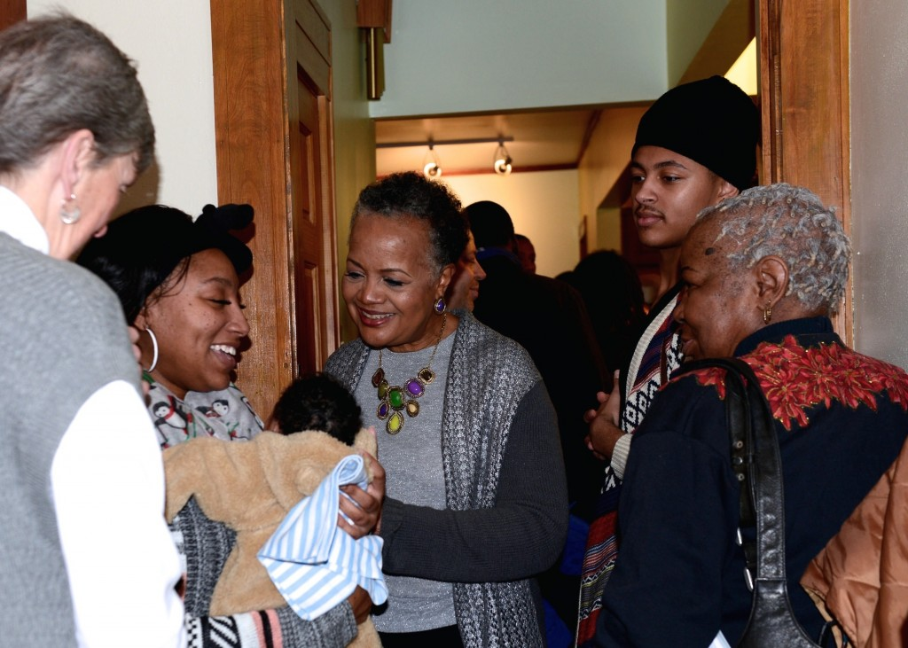 Sharon Adams mingles with community members during an event held to pay tribute to her and her work at Walnut Way, the organization that she co-founded. (Photo by Sue Vliet)