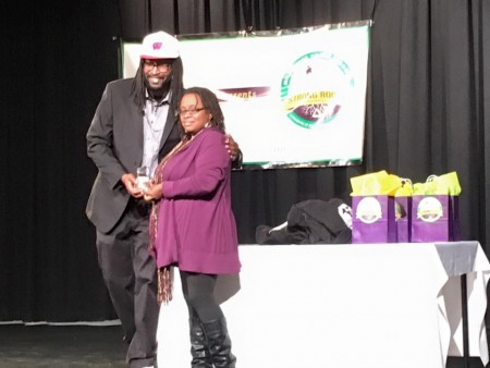 Venice Williams, right, received the Garden Of Honor award from Milwaukee Urban Gardens Program Manager Antoine Carter left, at the Groundwork Strong Roots Awards, December 3, 2015.