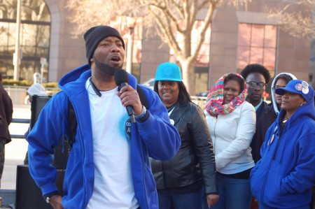 Dameion Perkins, one of Dontre Hamilton's brothers, sings a song of hope at a demonstration on April 30, 2015, to mark the first anniversary of Dontre Hamilton's death. (Photo by Andrea Waxman)