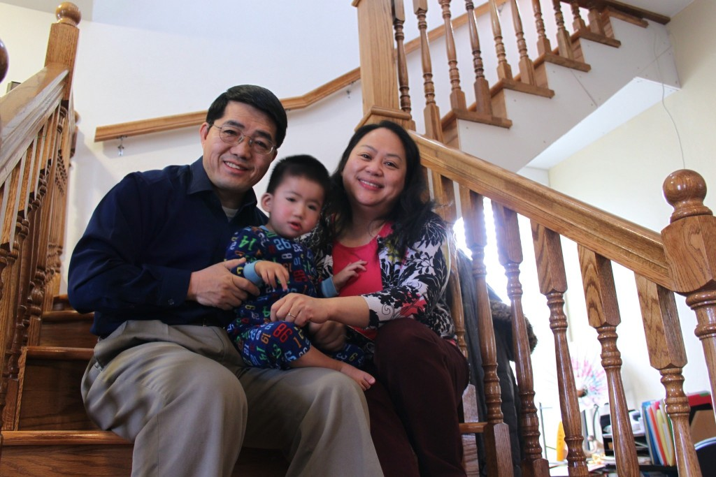 The Rev. Wang Chao Lee, wife Phua and son Yohan, along with family and members of their church, worked for more than a year rehabbing their new home. (Photo by Matthew Wisla)