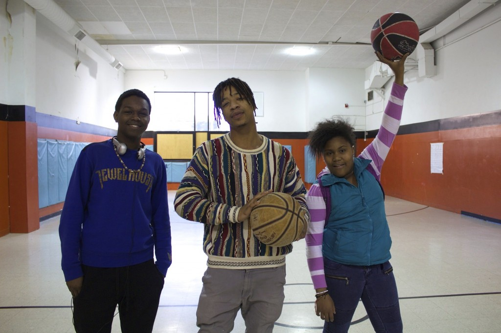 Rodney McCoy, Cameron Henderson and Zuriah Haynes pose during their basketball game. (Photo by Emmy A. Yates)