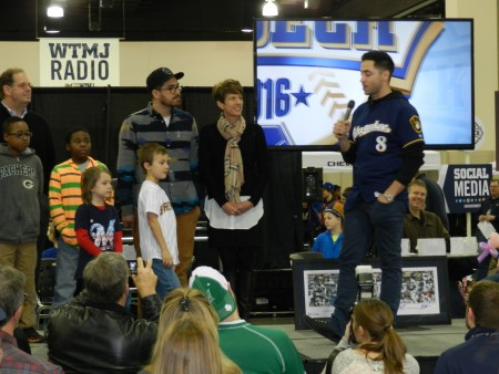 Milwaukee Brewer Ryan Braun (holding microphone) helps announce the new book at a recent Brewers On Deck event, while Doug Erlacher (left), Adam Carr, Lynda Kohler and invited children look on. (Photo courtesy of Sharp Literacy)