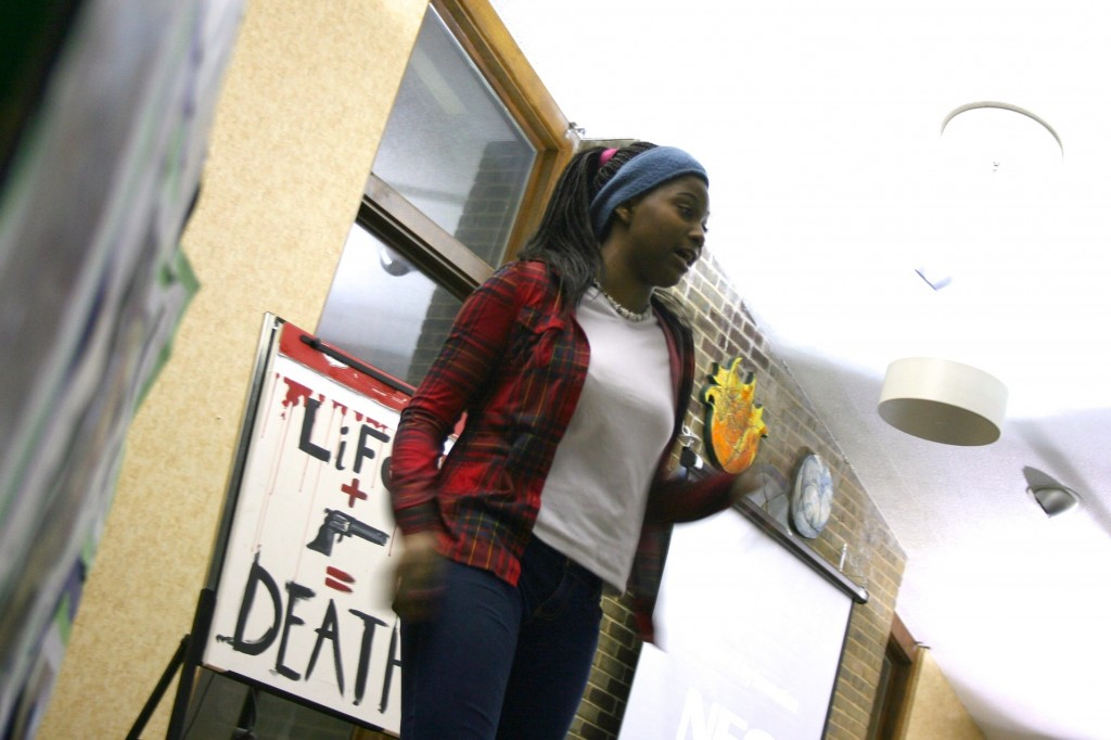 Kaliah Hughes-Bester, 15, performs a poem she wrote called 'Behind the Gun.' (Photo by Jabril Faraj)