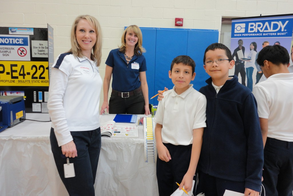 Volunteers help out at United Community Center's Bruce-Guadalupe Middle School Career Day. (Photo courtesy of United Community Center)