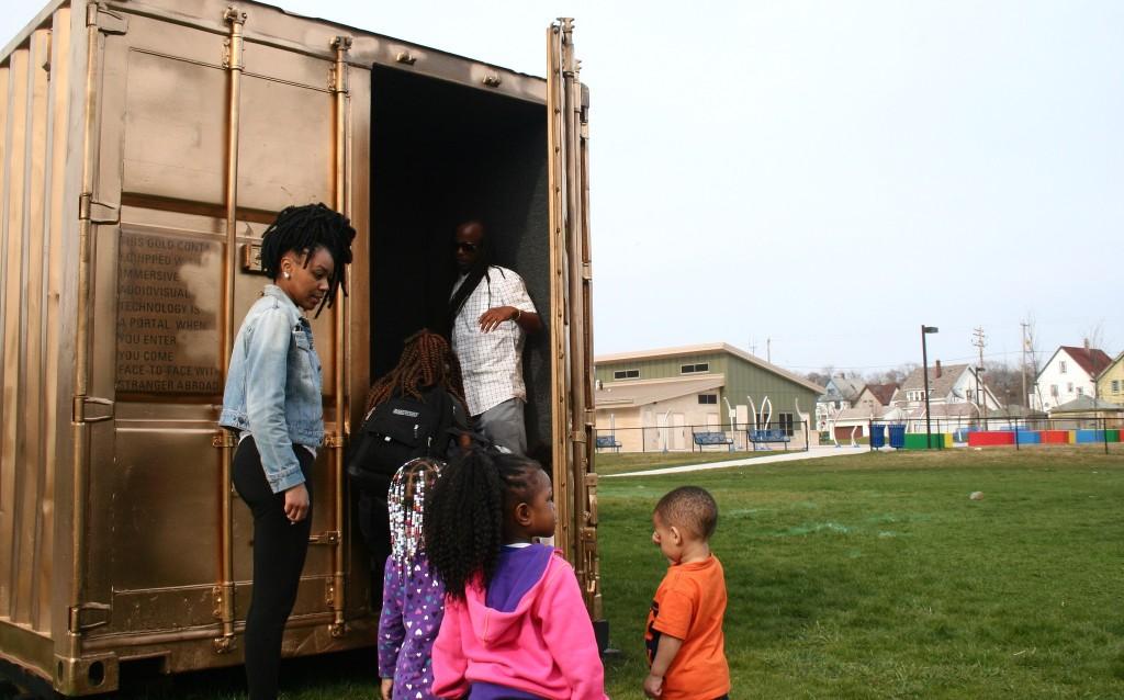 Neighborhood children enter the portal. (Photo by Jabril Faraj)