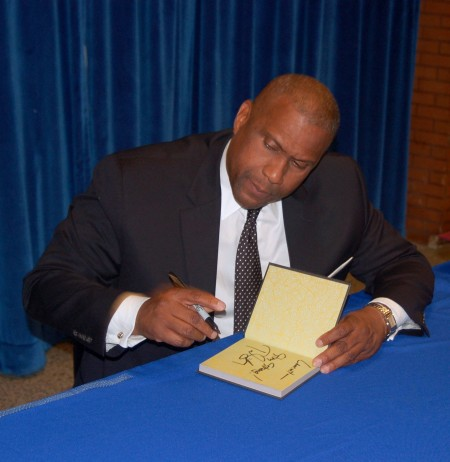 "Tavis Smiley signs copies of his new book, ""50 for Your Future"" at MATC. (Photo by Andrea Waxman)"
