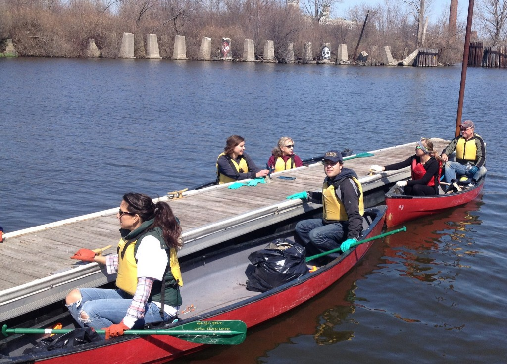 Volunteers collect garbage in the water using canoes during the annual event. (Photo courtesy of Milwaukee Riverkeeper)