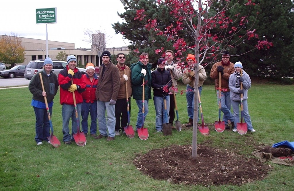 UPS employees and their families and friends plant a tree for Arbor Day. (Photo by Keep Greater Milwaukee Beautiful)