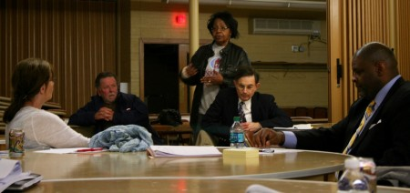Marva Herndon addresses Debra Jupka (left), Demond Means (right) and others at the advisory committee meeting. (Photo by Jabril Faraj)